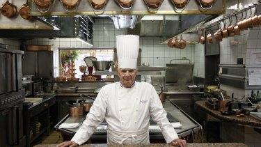 French chef Paul Bocuse poses outside his famed Michelin-star restaurant L'Auberge du Pont de Collonges in Collonges-au-Mont-d'or in 2011.