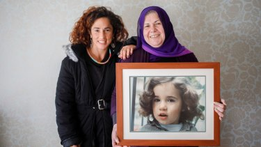 Bianca Elmir with her mother Diana Abdel-Rahman holding photo of her as a child.