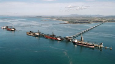Coal carriers are loaded Dalrymple Bay Coal Terminal jetties near Mackay.