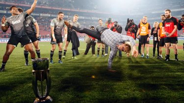 Busting a move: Crusaders coach Scott Robertson celebrates after beating the Lions at Ellis Park in the 2017 final.