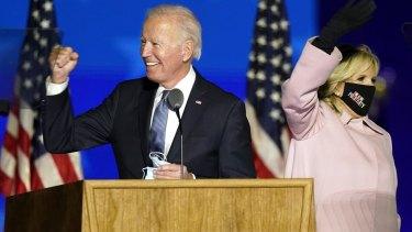 Democratic presidential candidate Joe Biden arrives with his wife, Jill Biden, to speak to supporters on Wednesday (AEDT) in Wilmington, Delaware.