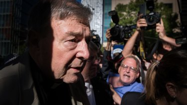 Cardinal George Pell arrives at the Melbourne County Court.