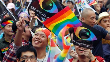 Supporters of LGBT and human rights wave rainbow flags during a rally in Tapei in 2016.