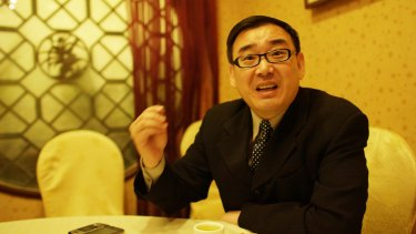 Yang Hengjun was surrounded by secret police as he waited in a queue at the airport.