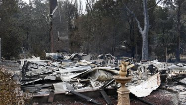 A burnt-out house is seen in Sarsfield, East Gippsland on Tuesday.