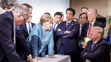 A photograph released by German Chancellor Angela Merkel\'s office captured the tense relations at the G7 summit.