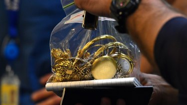 Suspected stolen gold found on a customer of Gold buyers Melbourne which was raided by the police.