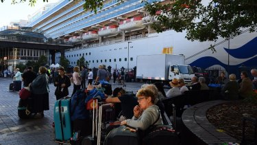 Passengers disembark from the Ruby Princess on March 19.