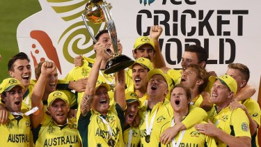 Home heroes: Michael Clarke holds up the 2015 trophy after Australia beat New Zealand in the World Cup final at the MCG.