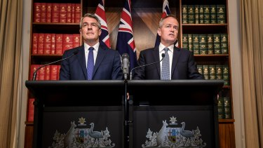 Sober suits: Shadow attorney-general Mark Dreyfus and opposition leader Bill Shorten in Canberra last month.