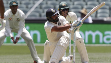 Reckless: Rohit Sharma hits the ball for six, only to be dismissed on the next delivery.
