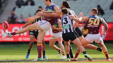 Collingwood and Brisbane playing on top of the Aboriginal flag in 2017.
