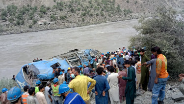 A bus carrying Chinese and Pakistani construction workers in north-west Pakistan fell into a ravine in an incident deemed a terrorist attack.