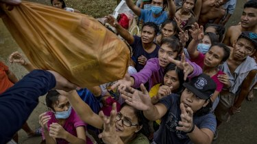 Residents affected by typhoon Vamco queue to receive relief goods in Tuguegarao, Philippines, in November.