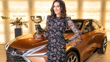 Megan Gale with the Lexus Melbourne Cup in Lexus ahead of the Melbourne Cup Carnival.