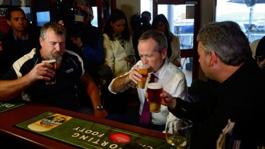 Mr Shorten has a beer with Beaconsfield mine disaster survivors Todd Russell and Brant Webb in Tasmania.