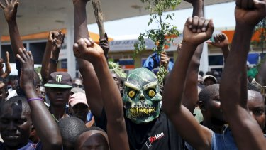 A protester wears a mask to hide his identity during a protest against President Pierre Nkurunziza's decision to run for a third term, in Burundi, in 2015.
