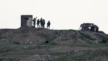 YPG fighters gather west of Kobani, northern Syria, on Tuesday. Turkey has vowed to launch a new offensive against YPG, the main component of a US-allied force that drove IS out of much of eastern Syria.