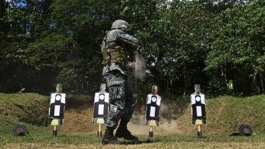 A Filipino marine fires at a target during training.