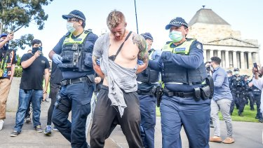 Facebook: a great place to share conspiracy theory and suspicions. Police make an arrest after a scuffle with anti-lockdown protesters at the Shrine of Remembrance.