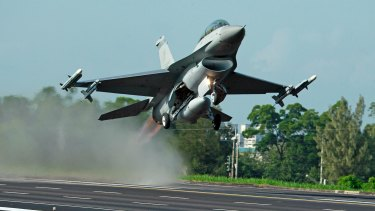 A Taiwanese F-16 fighter jet takes off.