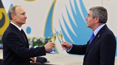 Russian President Vladimir Putin with IOC president Thomas Bach.