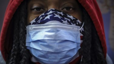 A subway rider wears a mask and a bandana for protection against COVID-19 in New York. The coronavirus has previously been found to be hitting black Americans particularly hard. A new study points to the same situation in the UK.