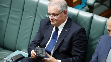 Treasurer Scott Morrison brings a lump of coal into Parliament in 2017.