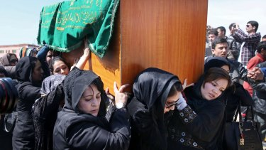 Afghan women carry the coffin of 27-year-old Farkhunda, beaten to death by a mob in 2015.