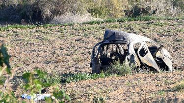 The wreckage of Daphne Caruana Galizia's car was strewn across a field after a powerful car bomb exploded.