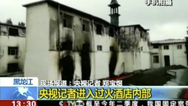 This image taken from a video footage run by China's CCTV on Sunday shows Beilong Hot Spring Hotel in Harbin's Sun Island resort area, following a fire.