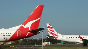 Qantas says its fuel bill will be $800 million more this year, while Virgin's will rise by about $88 million.