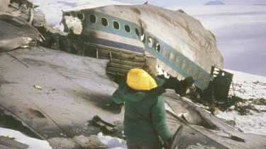 A rescue worker walks past the wreckage of an Air New Zealand DC10 plane.