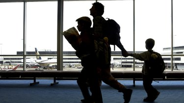 Travellers make their way through Sydney Airport.