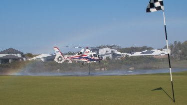 A helicopters takes on water to fight the Sunshine Coast bushfires.