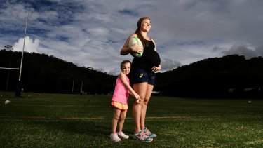 Nicole Beck, with 4 year old daughter Sophie. Rugby first sport to nut out policy on what to do with elite female athletes who have children.