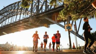 Participants run under the Harbour Bridge on Sunday morning.