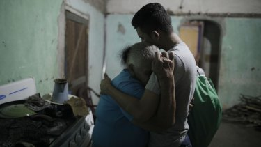 """The first Central American asylum seeker sent to Guatemala under that country's """"safe third country"""" agreement with the US, Erwin Jose Ardon, right, is welcomed home by his grandmother Elda Bardales, in Colon, Honduras, in November. He opted to return to his home in Honduras instead."""