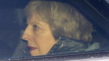 Theresa May outside Parliament.