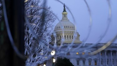 The US Capitol dome is seen past security fencing and barbed wire erected after the deadly January 6 riots.