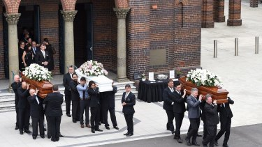 Mourners carry the coffins of Lars, Annabelle and Vivian Falkholt in January 2018.