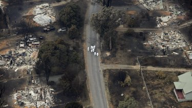 The devastation in Marysville, two days after Black Saturday. There were six Black Saturday class actions.