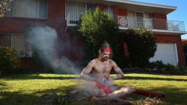 Brock Tutt prepares to perform a traditional smoking ceremony at his home in Matraville as part of the Haka and Corroboree for Life ANZAC online service on April 25, 2020 in Sydney, Australia.