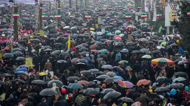 Iranians braved the rain to join in the march on Monday.