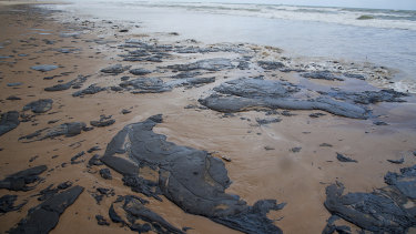 Spilled oil lays on the beach on Sergipe state, Brazil.
