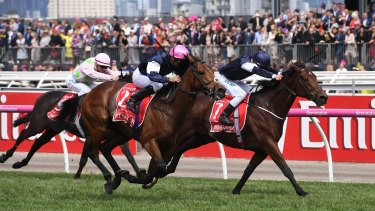 Rekindling ridden by jockey Corey Brown (centre) during their win at the 2017 Melbourne Cup at Flemington Racecourse.