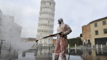 A worker carries out coronavirus sanitation operations in Pisa in 2020. The pandemic has created new opportunities for Italy's organised crime.