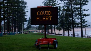 Sydney's Dee Why beach on Saturday. Many people's Christmas plans have been thrown into disarray by the pandemic.