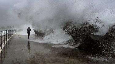 Waves crashing over the Wollongong Breakwall.