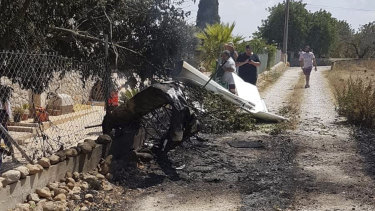 Authorities in Mallorca said seven people died in a collision between a helicopter and a light plane on the Spanish island.